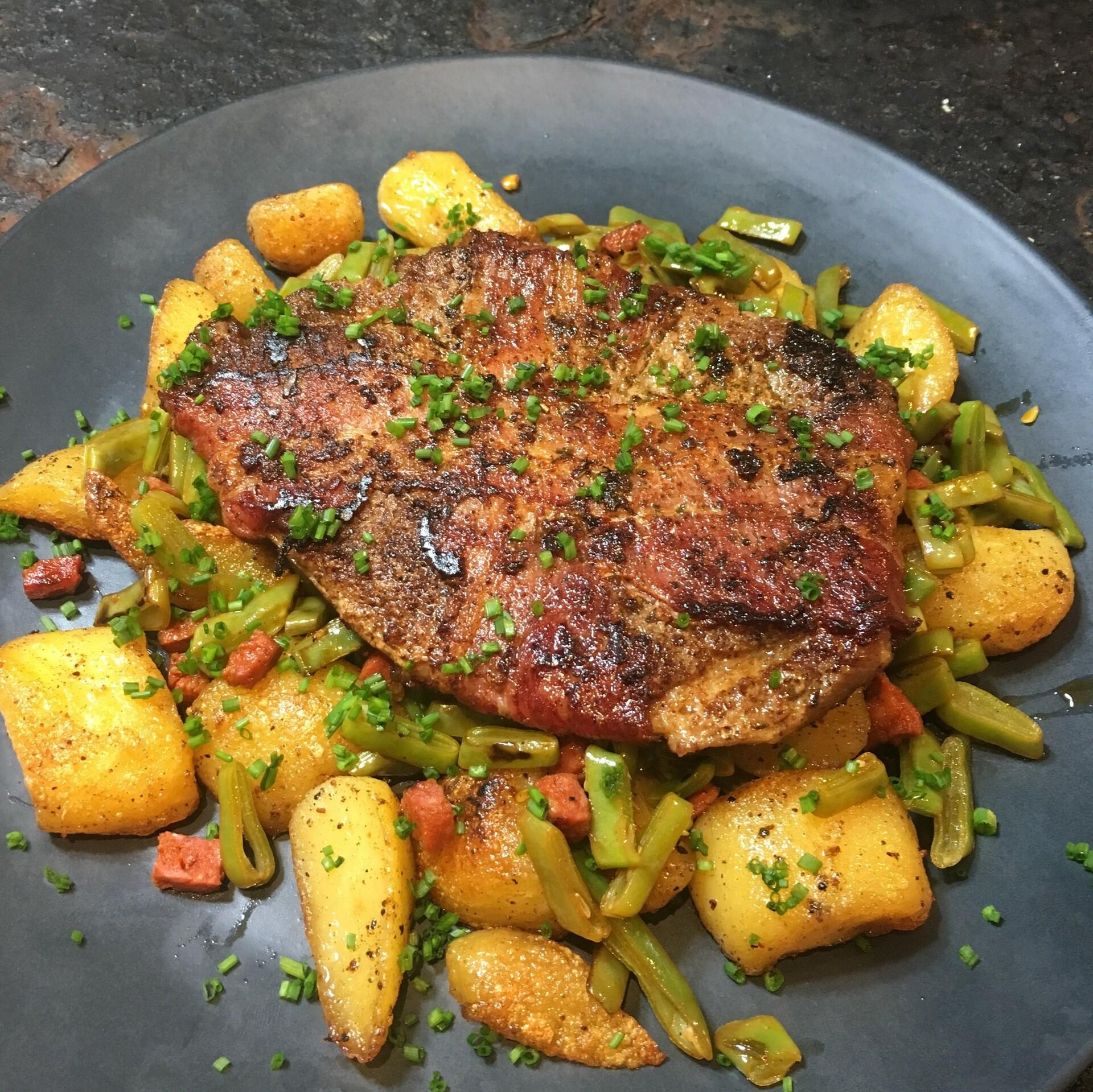 Houthakkerssteak met snijbonen, aardappel en chorizo